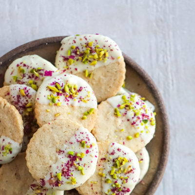 Thandai Shortbread Cookies dipped in White Chocolate w Pistachios and Rose Petals