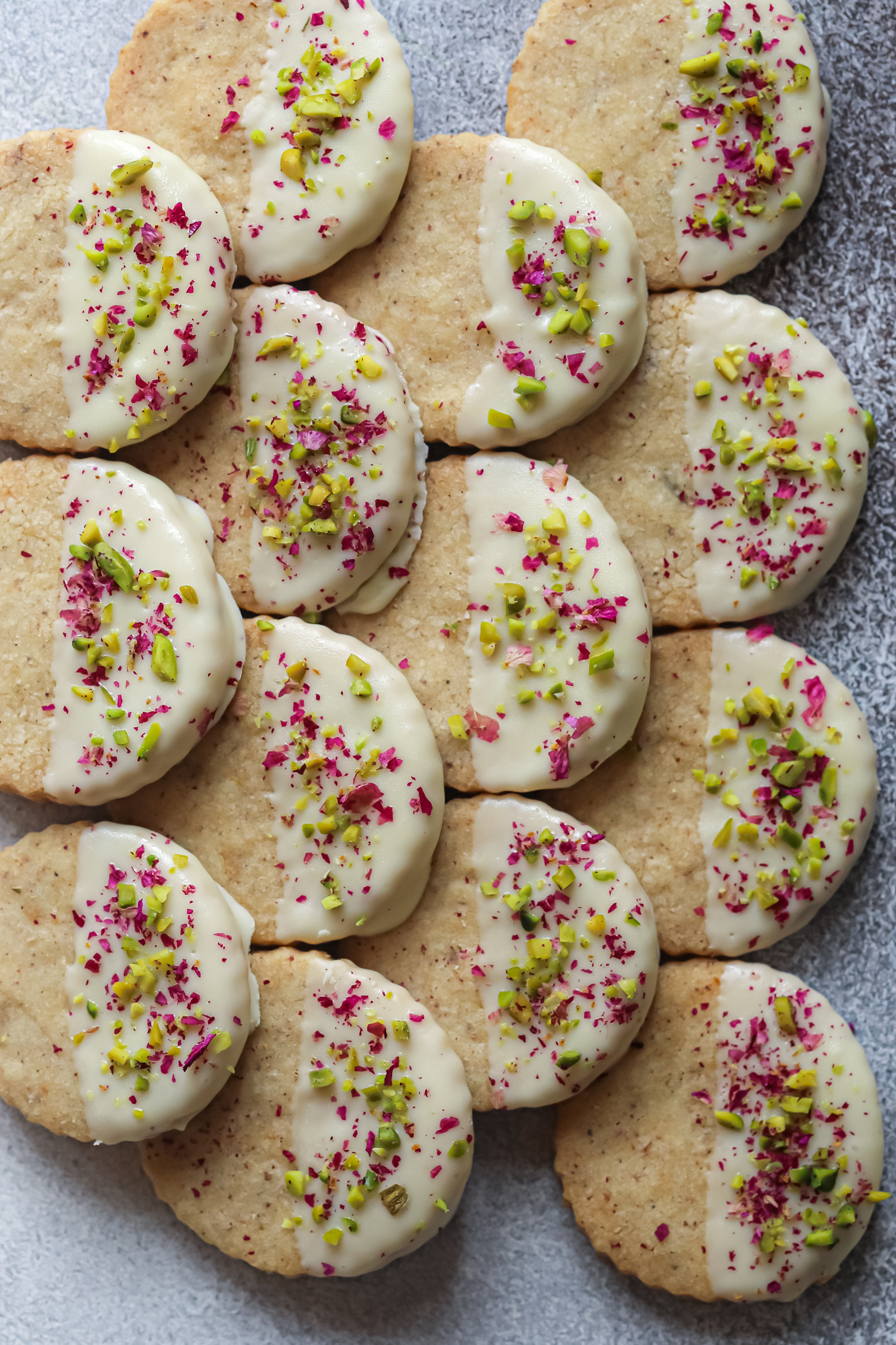 Thandai cookies dipped in white chocolate with pistachios and rose petals