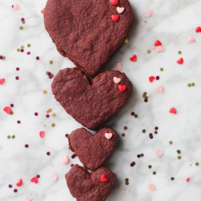 Raw Cacao and Beet Shortbread Hearts with a Raspberry Buttercream