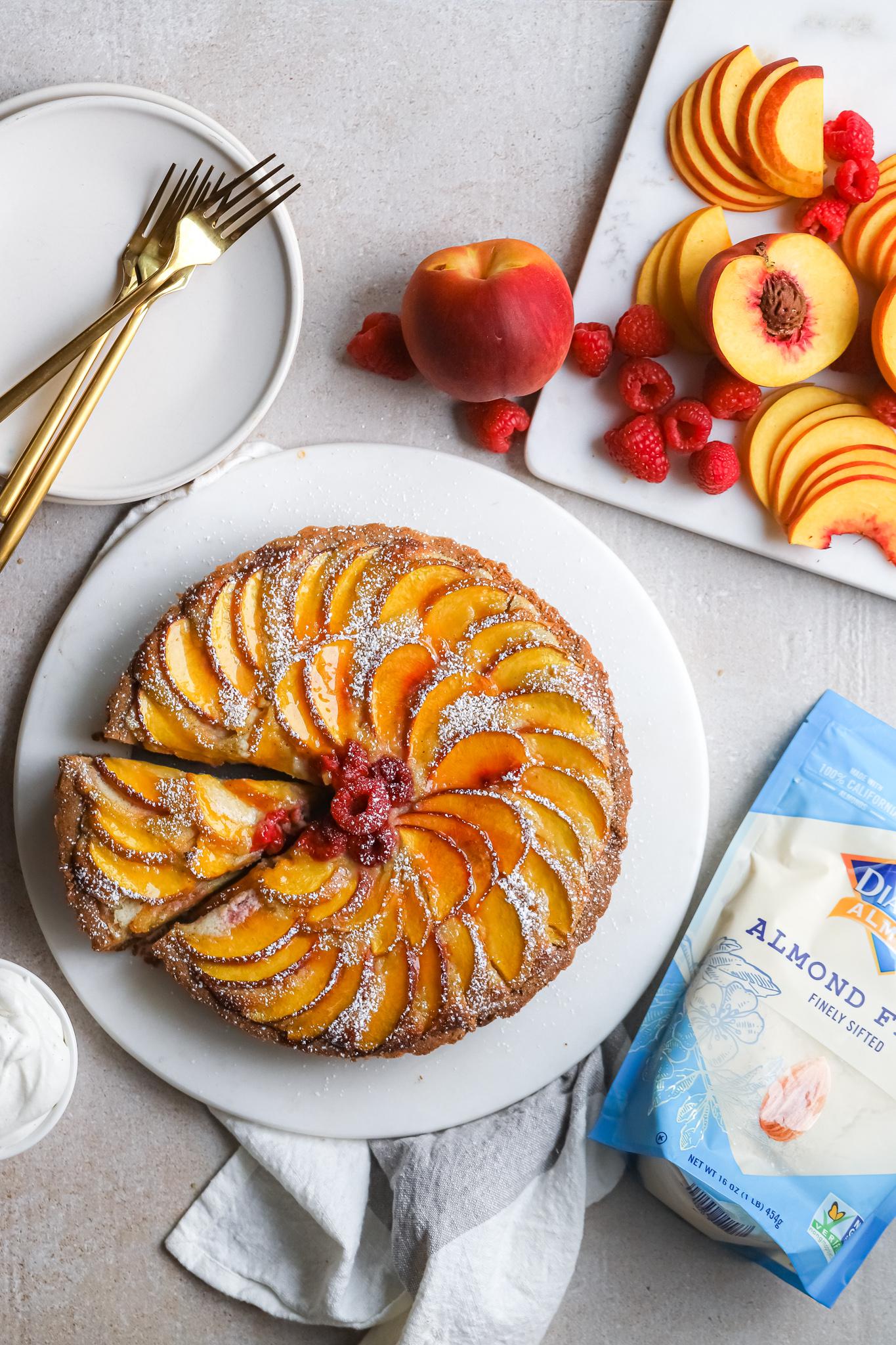 Slice slightly out Peach Raspberry Lemon Frangipane Tart